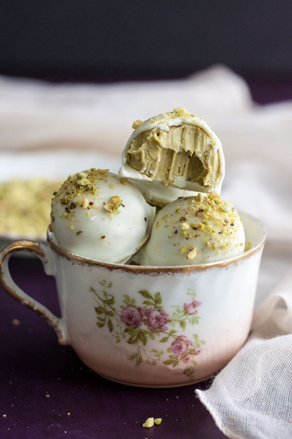 White Chocolate Pistachio Truffles in a tea cup