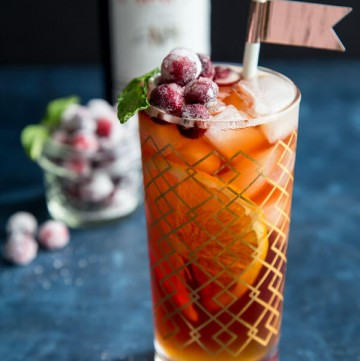 Cranberry Pimm's Cup cocktail in a highball glass
