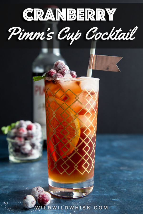 Cranberry Pimm's Cup is an easy and refreshing holiday cocktail made with Pimm's No. 1, apple cider, sparkling cranberry juice and garnished with sugared cranberries. #wildwildwhisk #pimmsno1 #pimmscup #cranberrypimmscup #sugaredcranberries