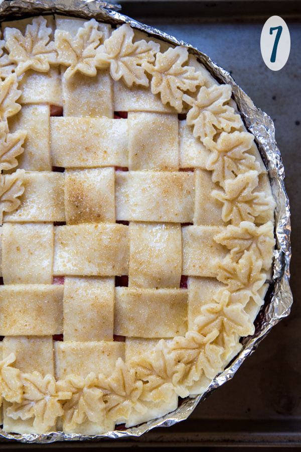 Adding a pie crust shield to Pear Pie before baking
