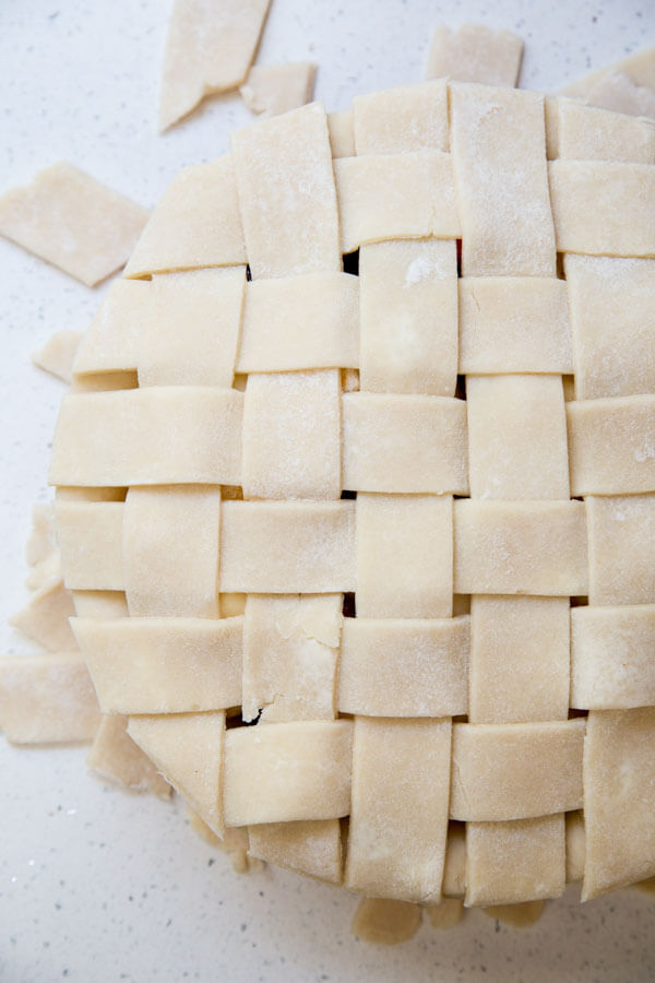 Complete lattice crust added to Pear Cranberry Pie