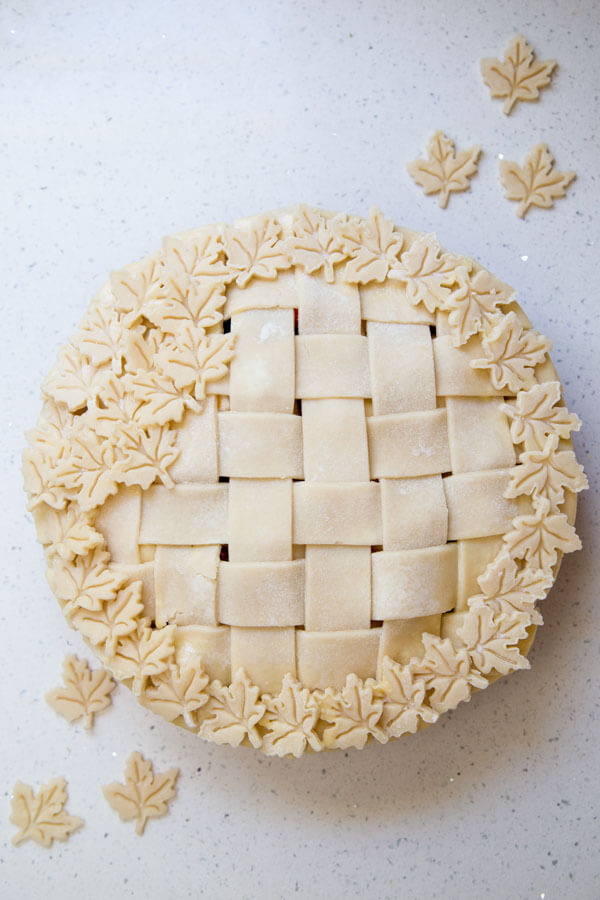 Unbaked Pear Cranberry Pie with decorative lattice top crust