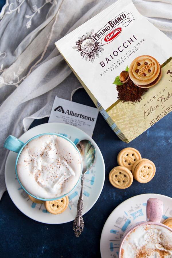 Homemade Hot chocolate with whipped cream and spices and Mulino Bianco cookies
