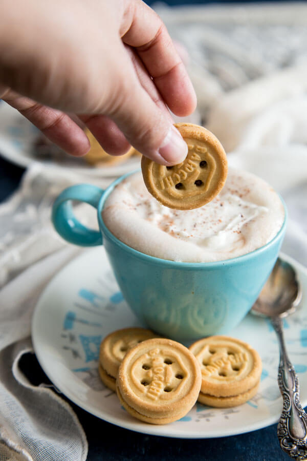 Dunking Mulino Bianco cookie into homemade hot chocolate