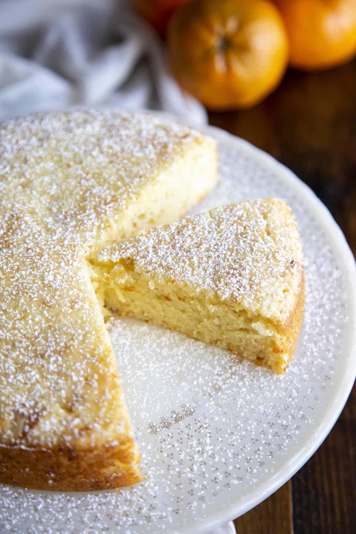 Scooping Tangerine Olive Oil Cake batter into mini bundt pans