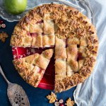 Pear Pie with cranberries in a red pie dish