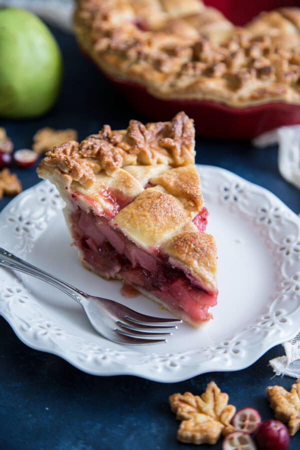 A slice of Pear Cranberry Pie on a plate