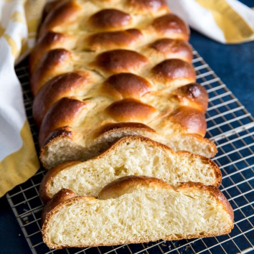 A loaf of Challah bread on a wire rack