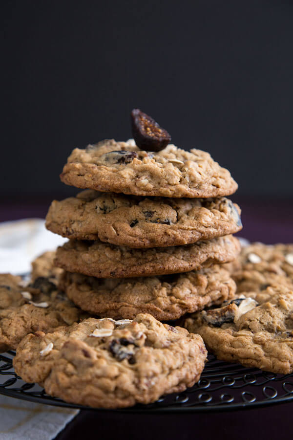 A stack of chewy oatmeal fig cookies on a cooking rack