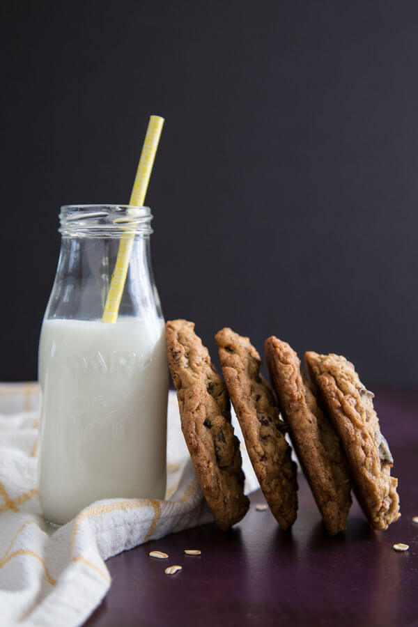 Chewy Oatmeal Fig Cookies leaning against a bottle of milk