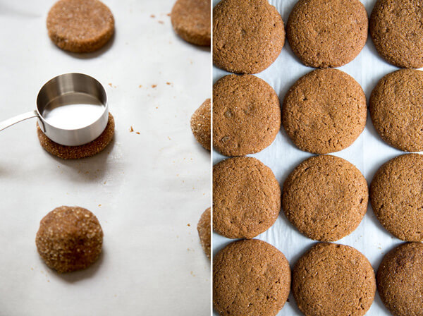 Flatten Ginger Molasses Cookies dough balls with a measuring cup for even spread during baking
