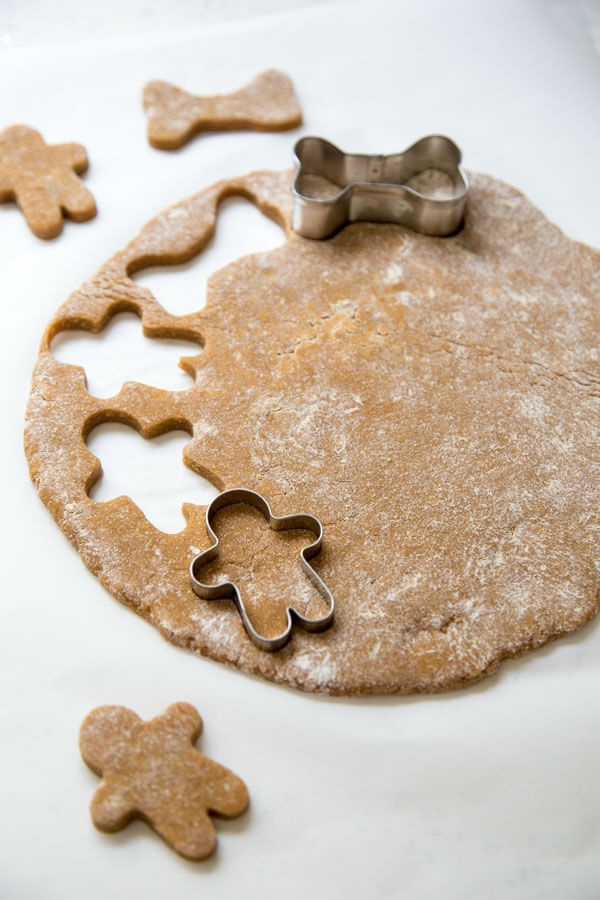Cutting shapes for Gingerbread Dog Treats using cookie cutters