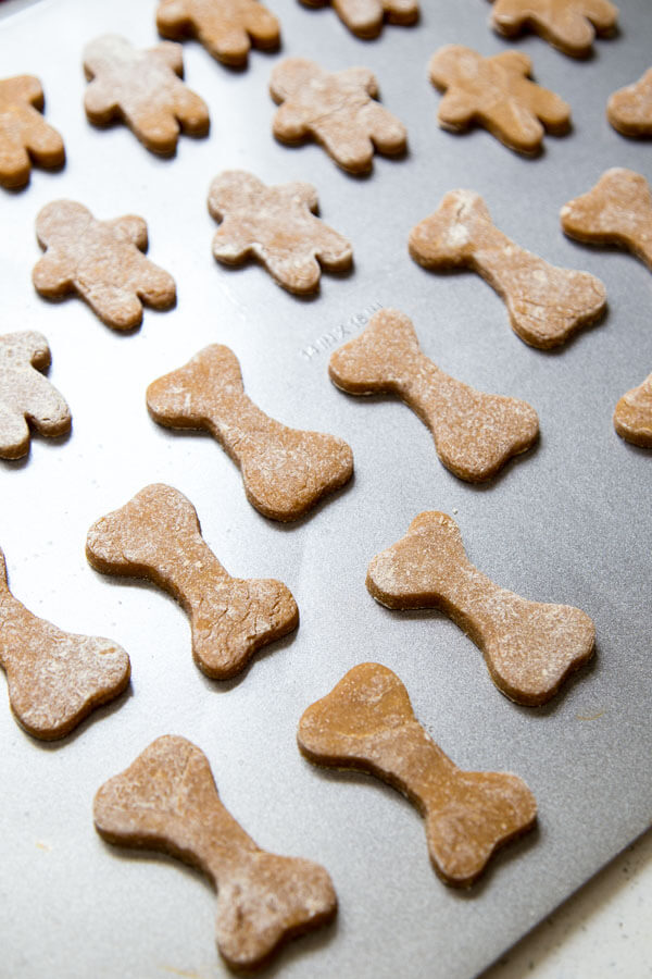 Gingerbread Dog Treats on a baking sheet reading for the oven