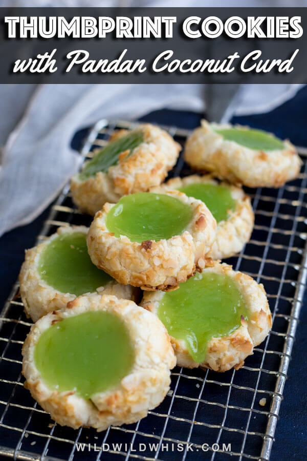 These Pandan Coconut Thumbprint Cookies are made with an easy shortbread cookie dough recipe, rolled in coconut flakes and filled with a pandan coconut curd. #wildwildwhisk #thumbprintcookies #pandan #coconut #shortbread #thumbprints #cookies #christmascookies #christmascookieexchange #christmascookierecipe
