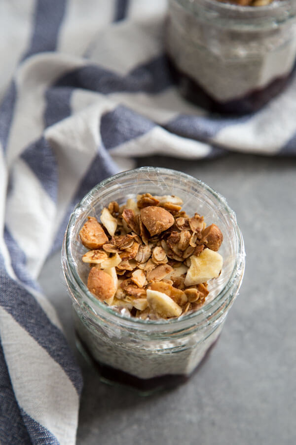 Coconut chia pudding with fruit compote and granola in a jar