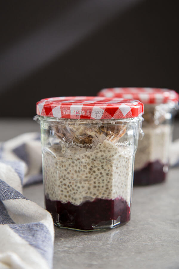 Meal prep Coconut chia pudding with fruit compote and granola in glass jars