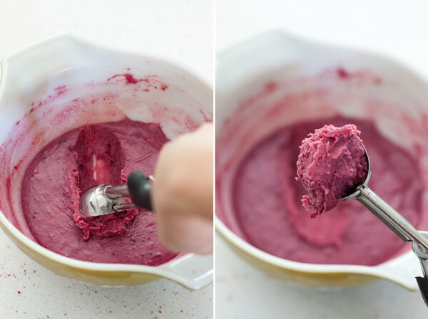 Scooping chilled raspberry chocolate truffle filling with an ice cream scoop