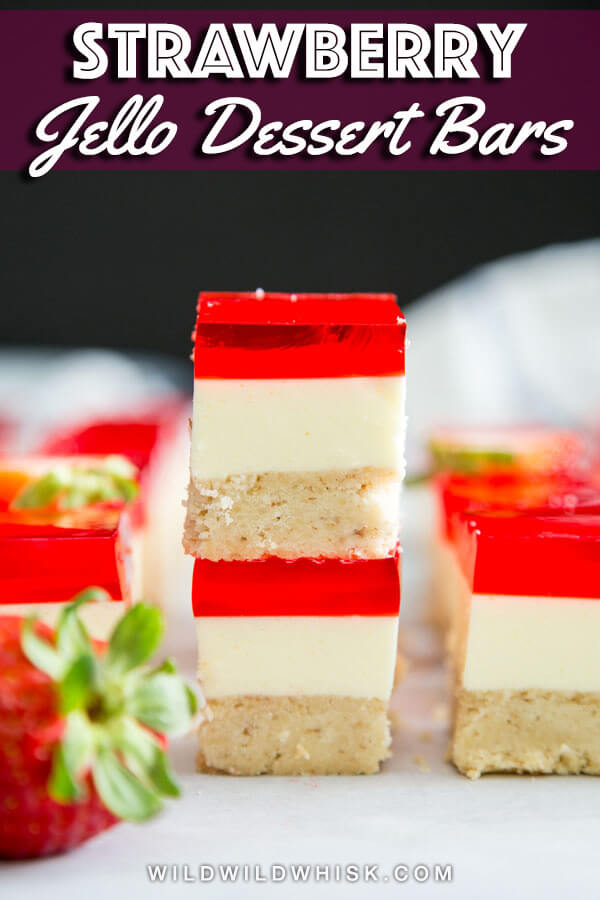 This Strawberry Jello Bars recipe is a hybrid of a strawberry pretzel salad and a no bake cheesecake with a walnut shortbread crust. #wildwildwhisk #strawberry #strawberryjello #cheesecakebars #walnutshortbread #strawberrydessert