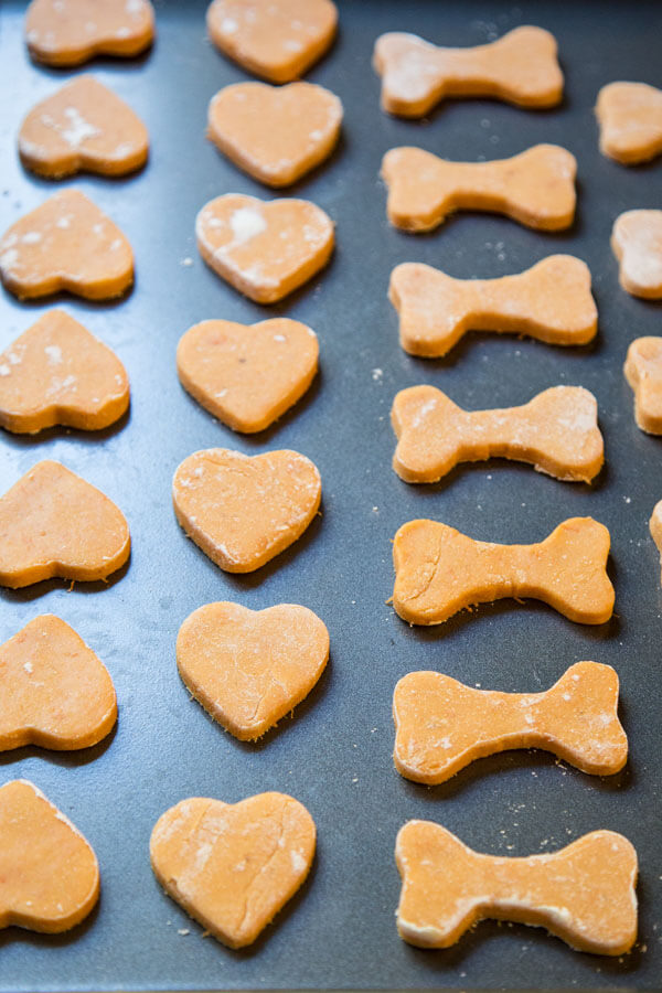 Sweet potato dog treats lined up on a baking tray ready for the oven