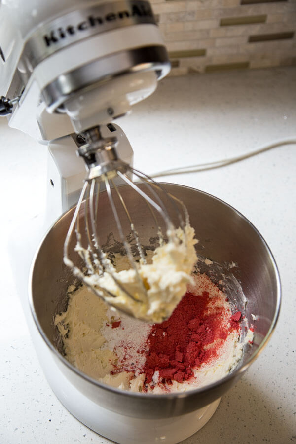 Add powder sugar and strawberry powder to cream mixture