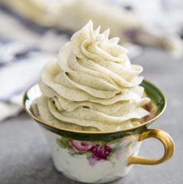 Vanilla bean swiss buttercream in a tea cup