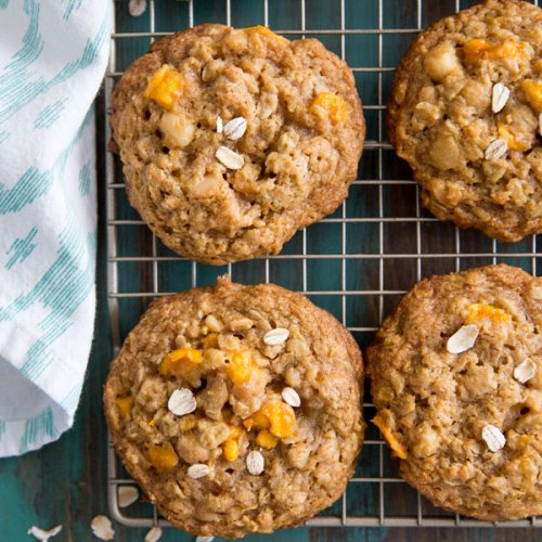 Tropical Mango Oatmeal Cookies resting on a wire cooking rack