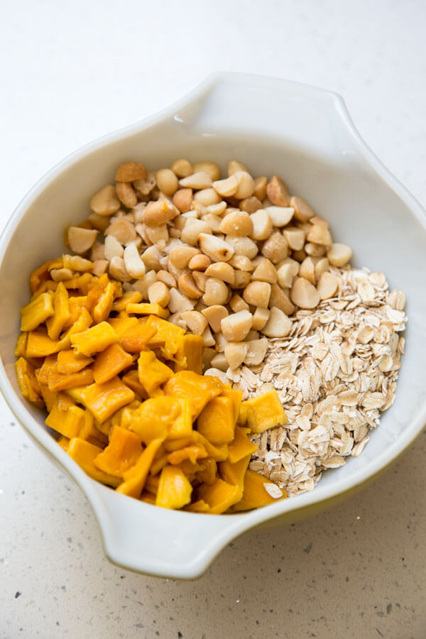A mix of mango, rolled oats, and macadamia nut for Tropical Mango Oatmeal Cookies