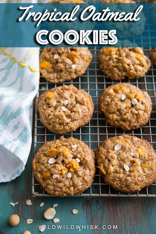 These chewy Tropical Mango Oatmeal Cookies got delicious dry mango pieces mixed in with rolled oats and chopped macadamia nuts to give you a piece of paradise. #wildwildwhisk #oatmealcookies