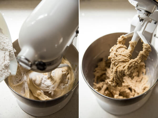Flour is added to the liquid ingredients in a stand mixer bowl