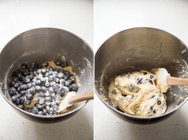 Adding blueberries to the muffin batter