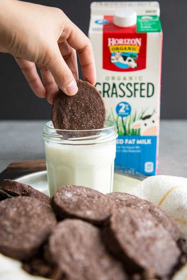 Dunking a cookie into a glass of milk