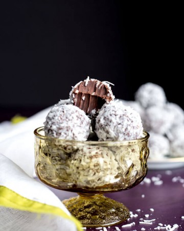 Coconut truffles piled in a glass cup