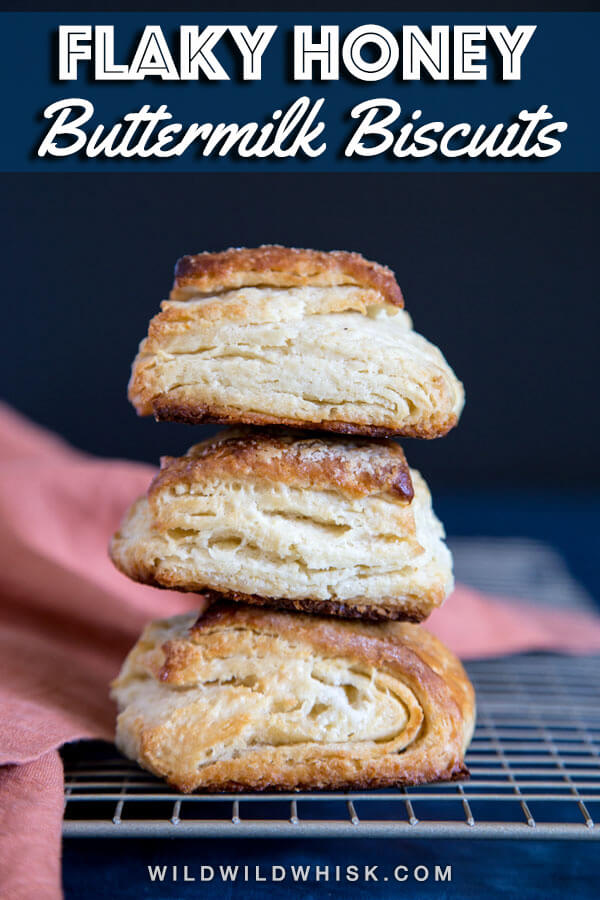 Flaky and fluffy Honey Buttermilk Biscuits are made with buttermilk and sweetened with honey. These sweet biscuits have layers upon layers of pillowy soft and fluffy goodness. #wildwildwhisk #biscuits