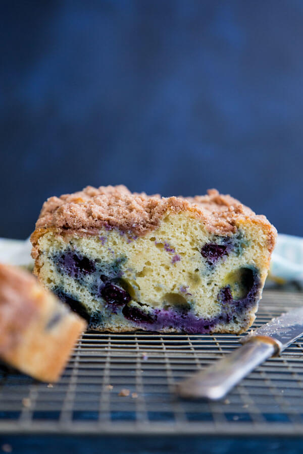 A cross-section photo of a Blueberry coffee cake on a wire rack