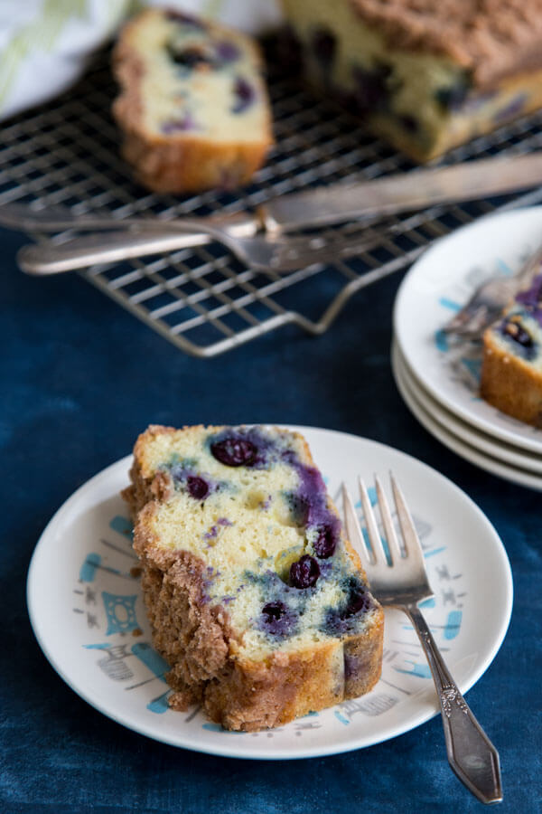 A slice of blueberry coffee cake on a plate