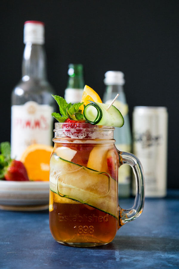 A pimm's cup cocktail with all the garnishing on top