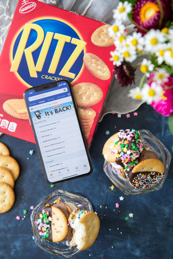 Ritz crackers ice cream sandwiches in a sundae glass next to a box of Ritz crackers and a cellphone