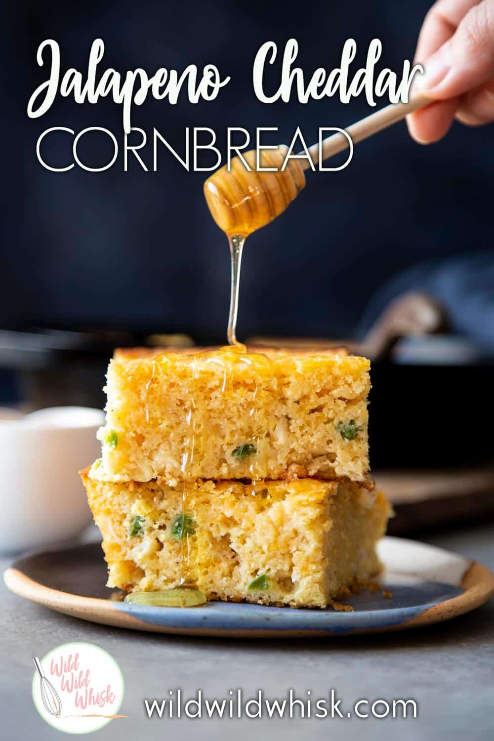 Easy and cheesy Jalapeño Cheddar Cornbread is loaded with shredded cheddar cheese and jalapeño pieces, baked in a cast iron skillet. #wildwildwhisk #cornbread