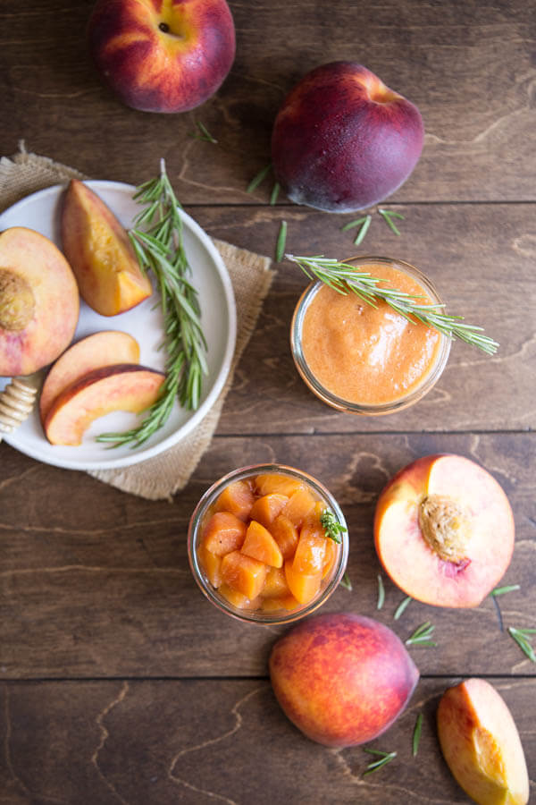 Peach compote and peach sauce in jars next to fresh peaches