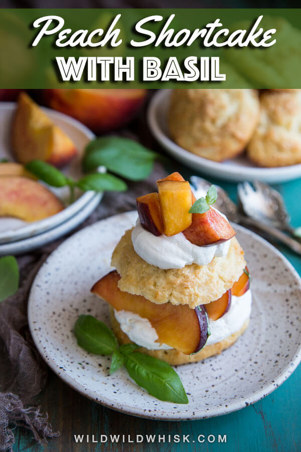 Enjoy peach season with this easy Peach Shortcake recipe, made with drop biscuits, homemade whipped cream and macerated fresh peaches with sweet basil. #wildwildwhisk #peachshortcake
