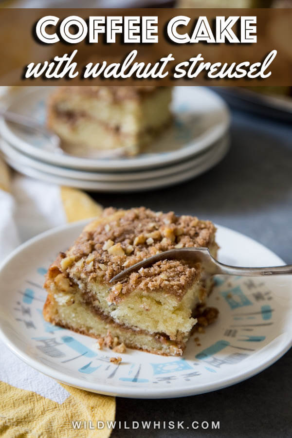 A slice of Sour Cream Coffee Cake with lots of crunchy walnut cinnamon streusel is the perfect pairing with your coffee on a crisp morning. #wildwildwhisk #coffeecake