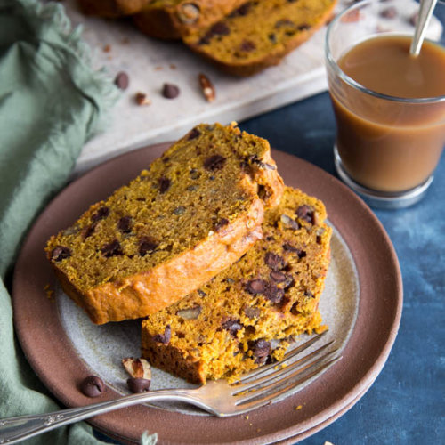 Chocolate chip pumpkin bread slices on a plate