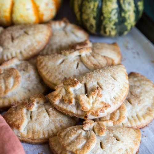Pumpkin hand pies on a baking tray