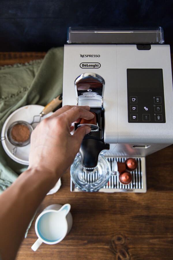Using the Nespresso machine to make coffee