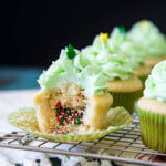 Pinata cupcakes filled with Christmas sprinkles
