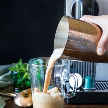 Pouring Vietnamese iced coffee into a mug
