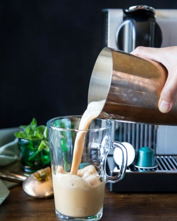 Pouring Vietnamese iced coffee into a mug