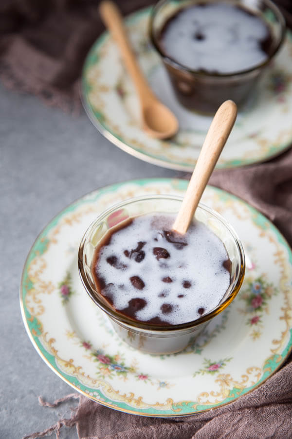 Vietnamese black bean dessert with coconut milk in a small bowl