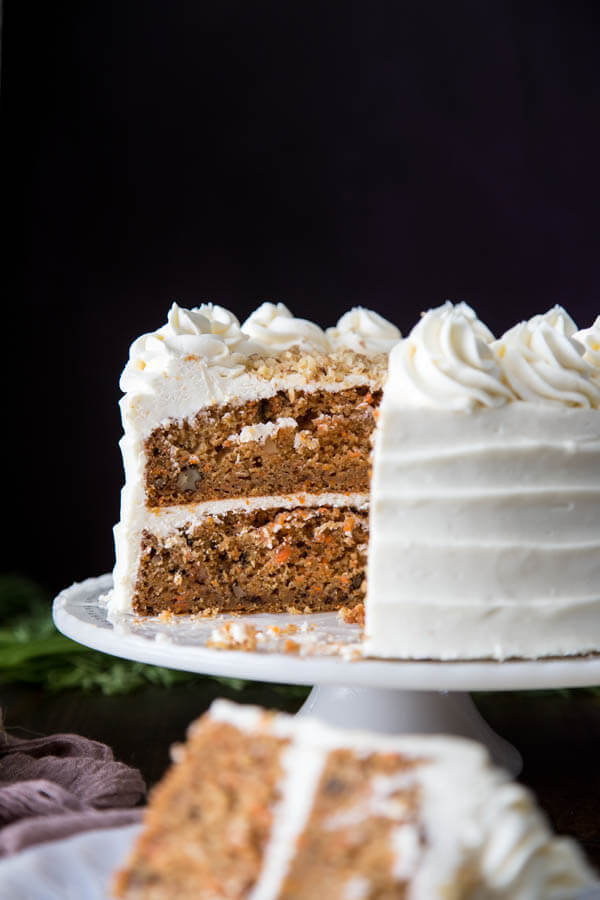 A carrot cake on a cake stand