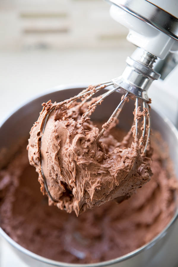 Chocolate buttercream frosting in a stand mixer